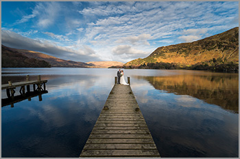 Inn on the Lake, Ullswater. Beautiful wedding couple of the hotels Jetty overlooking Ullswater.